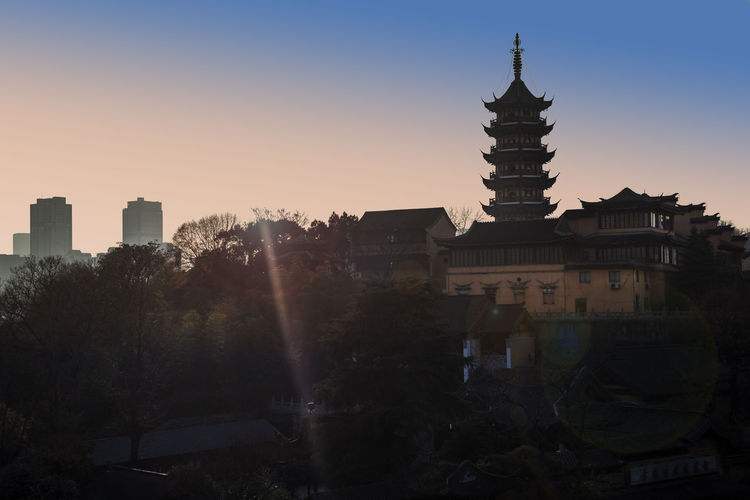 The sunset of an ancient temple Ancient Pagodas Ancient Temples Buddhism Religious  Tower Temple Scape Architecture Building Exterior Built Structure City Clear Sky Day Nature No People Outdoors Place Of Worship Religion Sky Spirituality Sunset Temple Tree