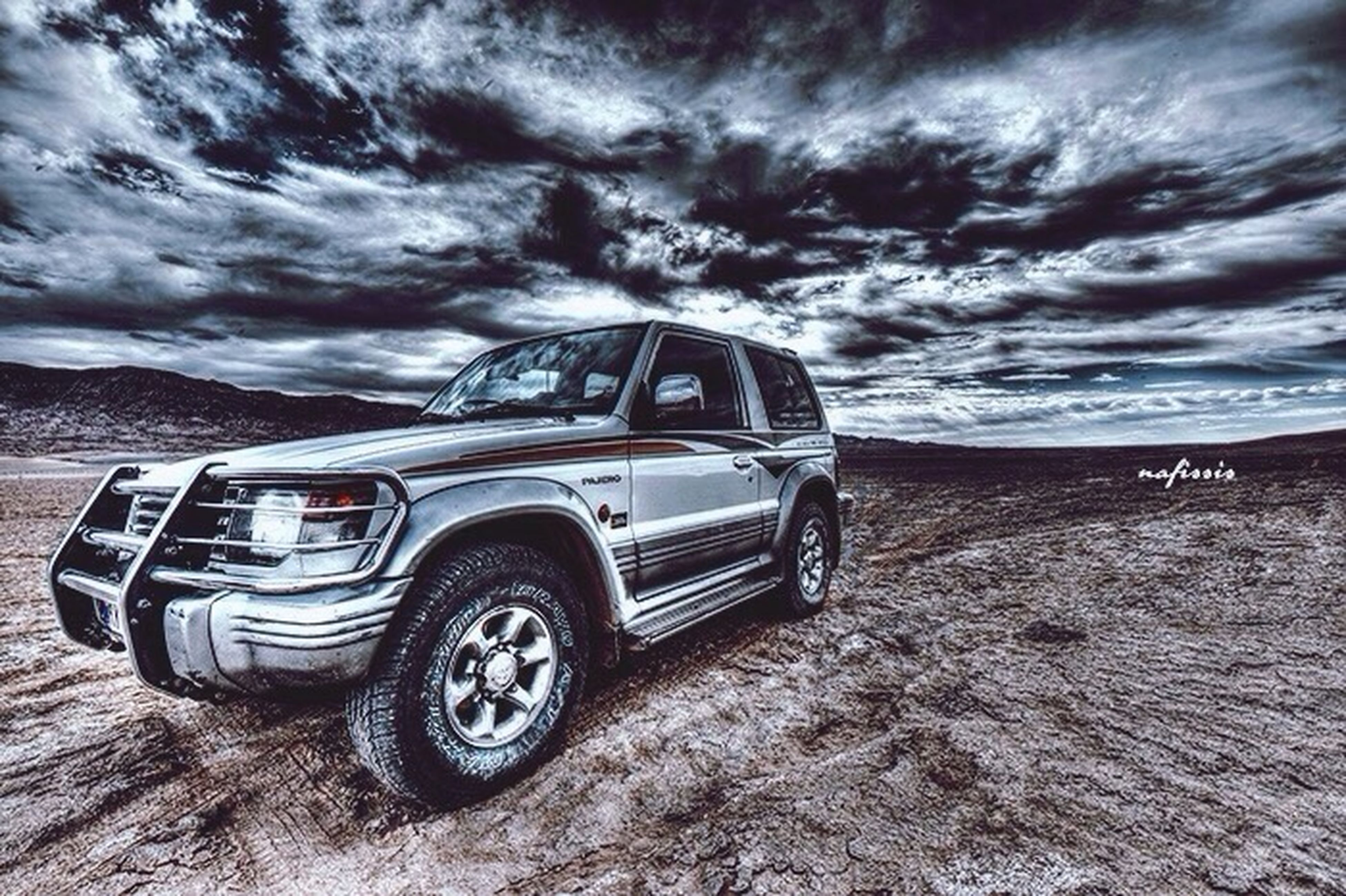 sky, cloud - sky, sand, beach, cloudy, transportation, land vehicle, mode of transport, cloud, sea, shore, tranquility, nature, outdoors, car, day, tranquil scene, scenics, no people, beauty in nature