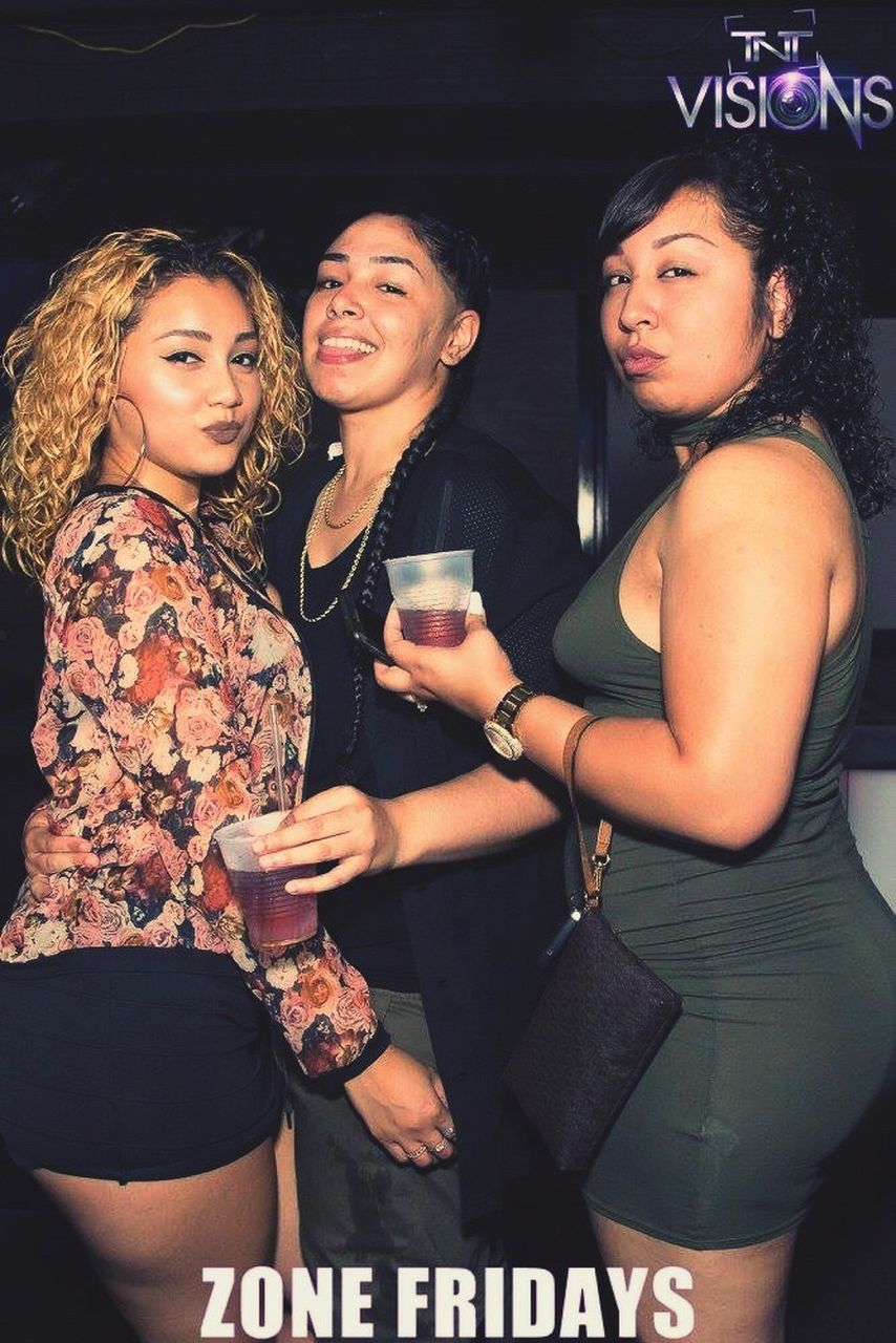 three quarter length, friendship, young adult, young women, night, togetherness, leisure activity, nightlife, lifestyles, happiness, beautiful woman, real people, nightclub, indoors, smiling, people