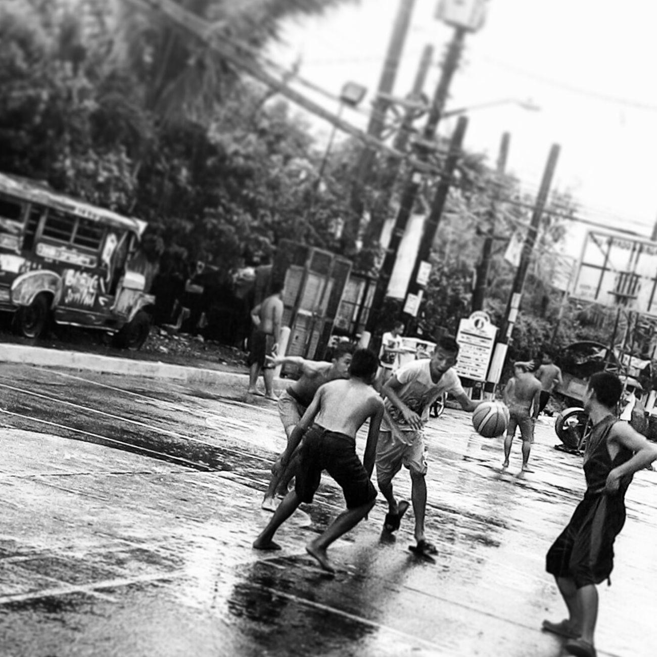 These boys don't mind the pouring rain. Blackandwhite Streetphotography Streetphoto_bw The Street Photographer - 2015 EyeEm AwardsEeyem Photography Eyeem Philippines Rainy Days Streetbasketball Sports Photography Mobile Photography
