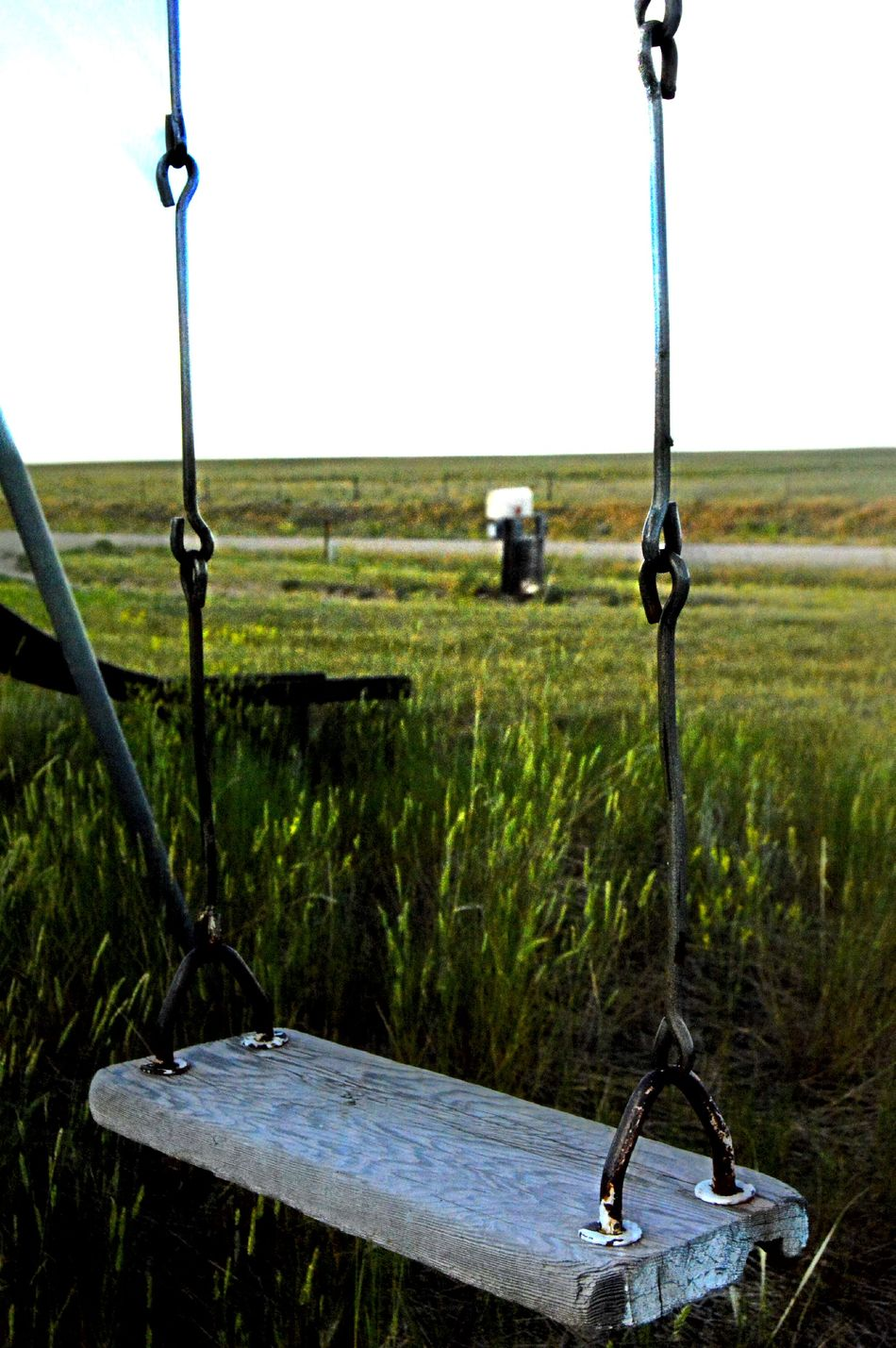 Face East Grass Still In July Hot Summer Day No People Old Swing Set Out In The Country Prairie Center Wyoming Wood Swing Seat