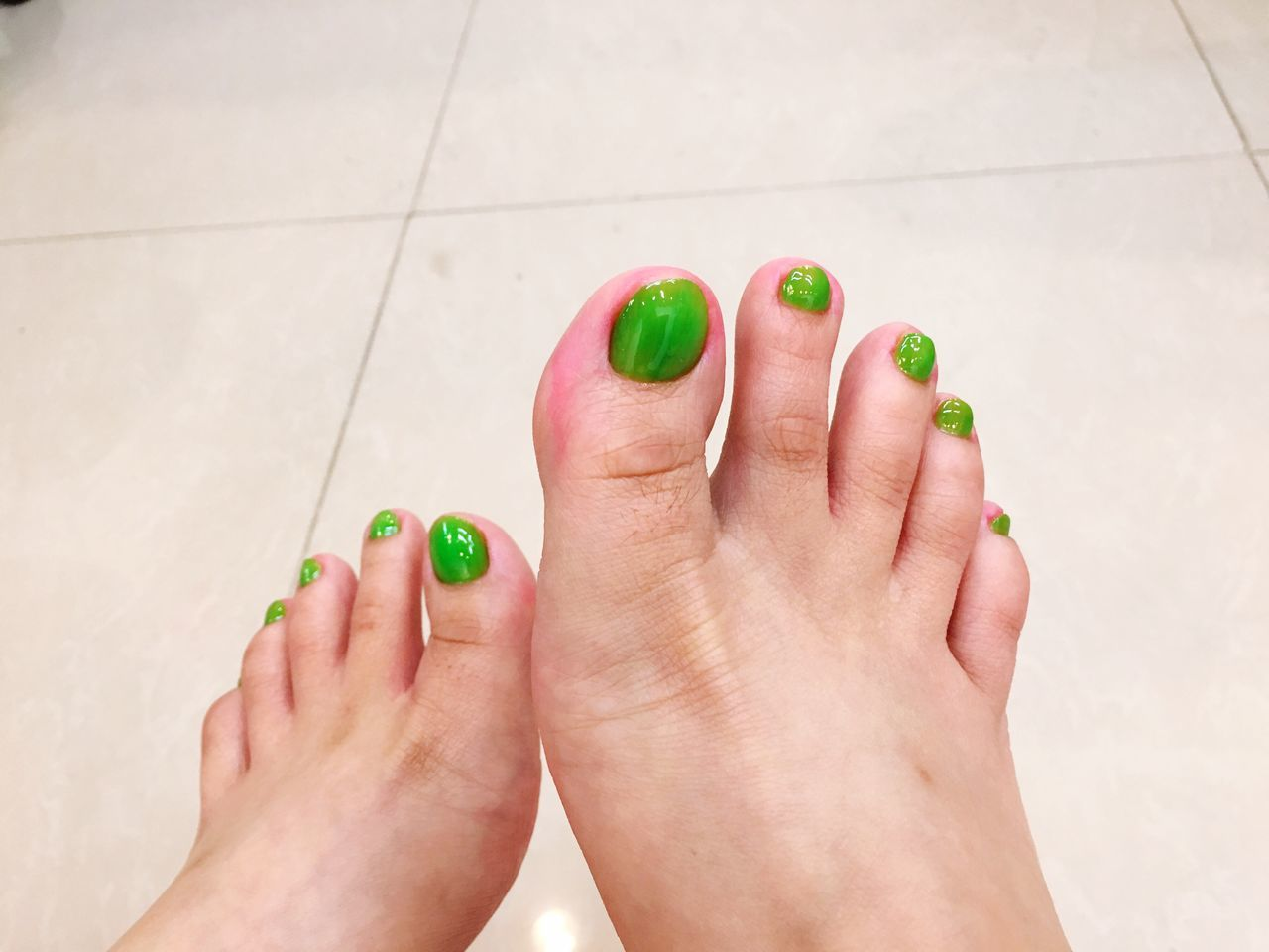 EyeEm Selects Green Nail Polish Human Body Part Human Foot Barefoot Toenail Human Leg Women Nail Polish Low Section Real People One Person Indoors  Leisure Activity Pedicure Close-up Day Adult People