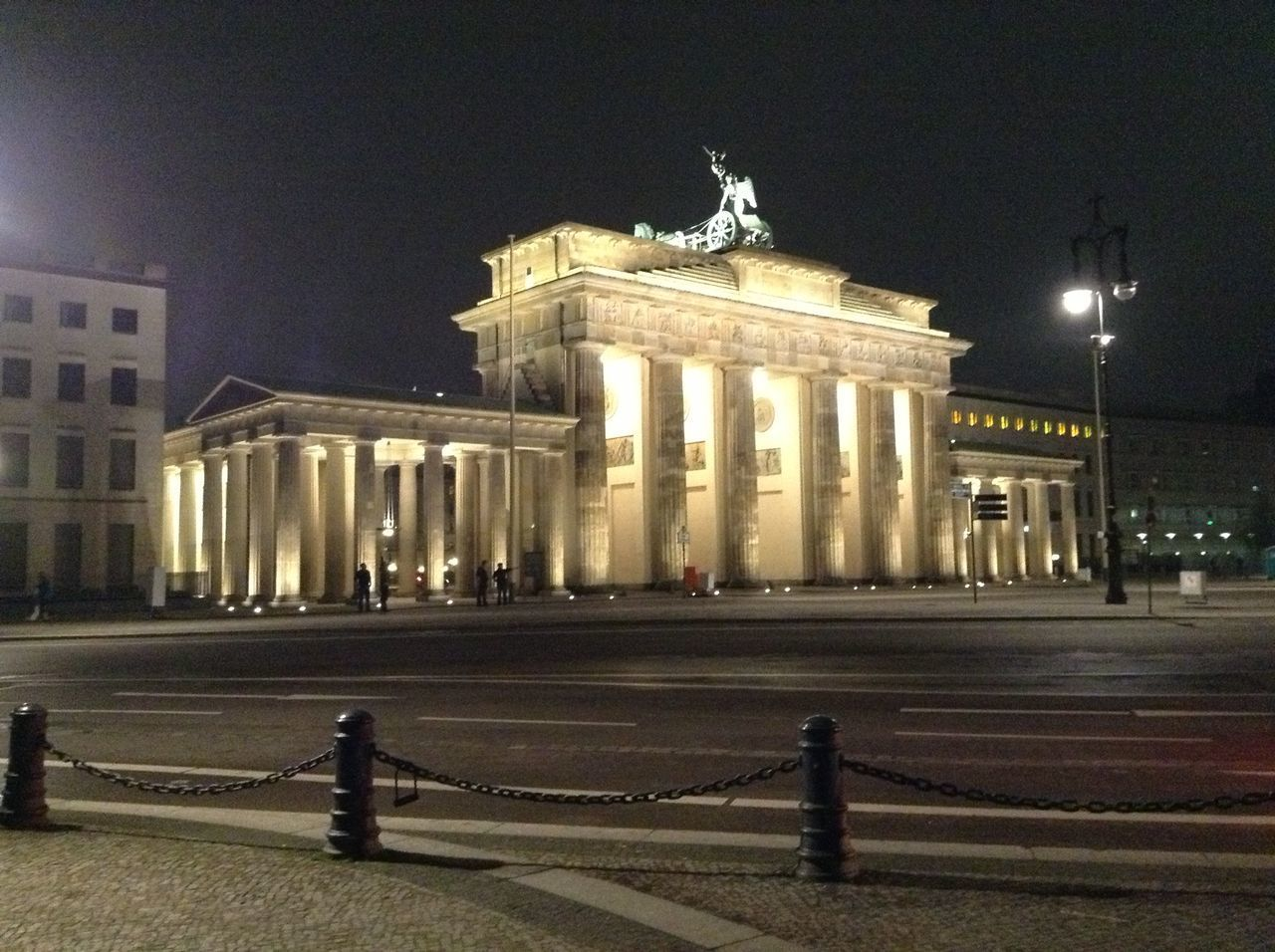 The Brandenburg Gate is a symbol of both the once devided city and the reunification of it. In most cases the square in front of the Gate is crowded by visitors. I was lucky to find a moment of silence and watch the Gate in all its magic. Berlijn At Night Brandenburg Gate Berlijn City Illimunated Night No People Travel Destinations