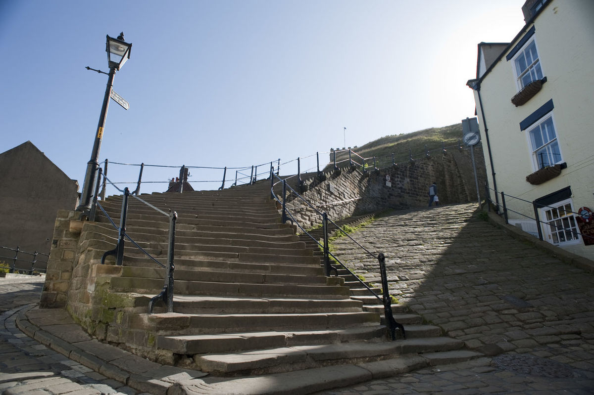 Church stairs in Whitby, North Yorkshire, winding their way up Tate Hill from the town to St Mary's medieval church Ascending Bottom Church Stairs Church Street England Hillside Historical Landmark Medieval North Yorkshire Pedestrian St Marys Church Stairs Steep Steps Tate Hill Travel Whitby