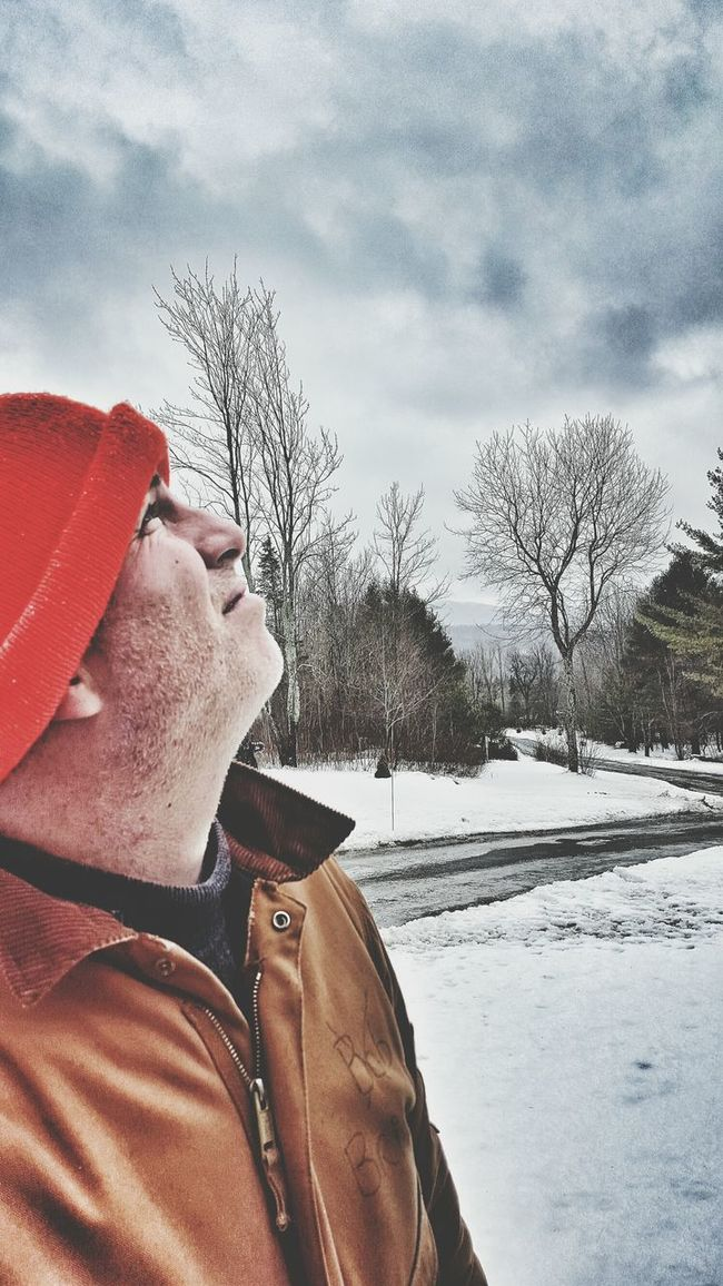 More clouds with rain and snow. Plow guy looking up wondering what else winter has in store. Contemplating Not Smiling Close-up Serious Looking Up Man At Work Work Suit Ski Cap Cold Weather Outdoors Unshaved Gritty Winter Plow Guy Real People Candid Side Profile Clouds And Sky Barren Trees Men Weather Copy Space Lookingup Heaven