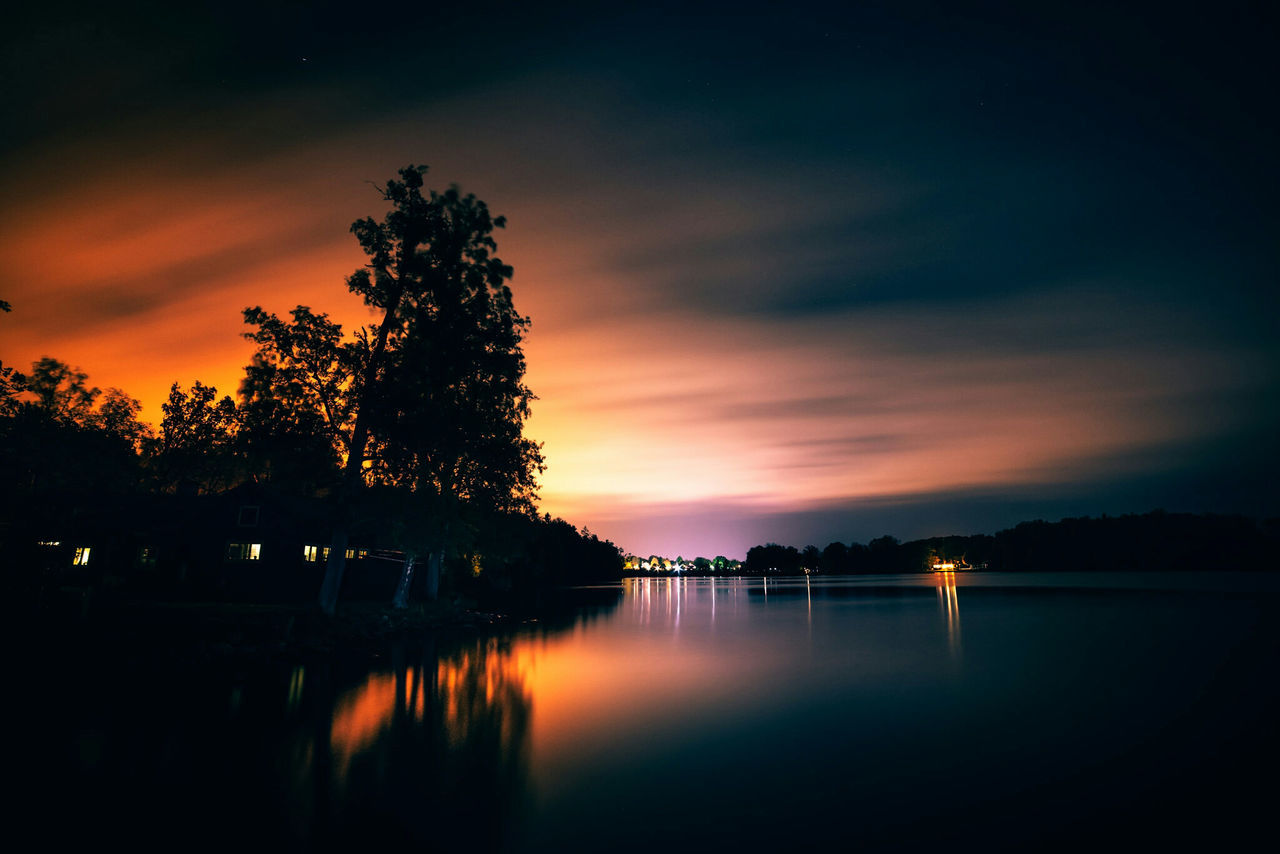 My town. Sunset Silhouette Tree Water Tranquil Scene Scenics Reflection Tranquility Lake Sky Orange Color Atmospheric Mood Atmosphere Cloud - Sky Sunset Silhouette Tree Water Tranquil Scene Scenics Reflection Tranquility Lake Växjö