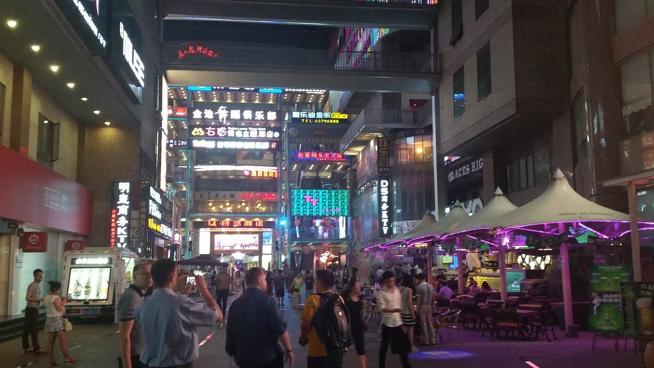 illuminated, large group of people, night, building exterior, architecture, men, neon, built structure, city, real people, women, store, crowd, outdoors, people, adult