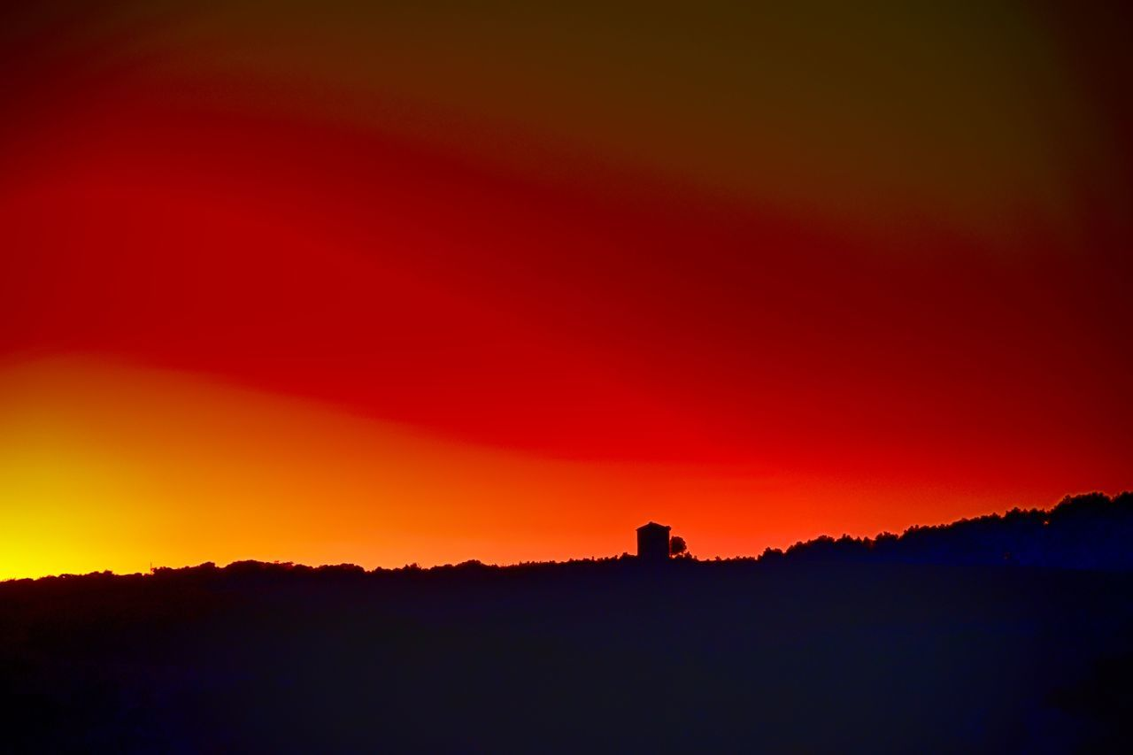 silhouette, sunset, orange color, nature, beauty in nature, outdoors, tranquil scene, red, tranquility, scenics, no people, sky, architecture, building exterior, day