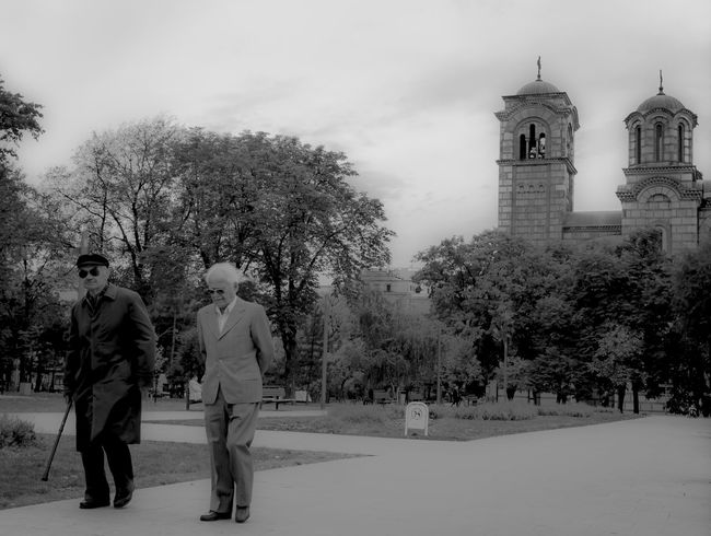 Old Friends Architecture Belgrade Belgrade,Serbia Beograd Black And White Photography Blackandwhite Built Structure Men Old Old Style Outdoors People Serbia Sky Tree Two People Walking Friends Friendship Old Friends Lifetime Your Ticket To Europe