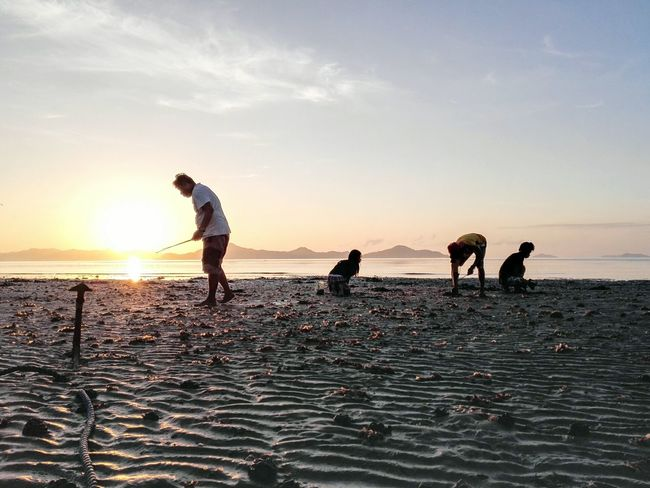"""Wak-wak hunting early morning at Sibaltan Beach.""""Wak-wak"""" is a local term for sandworms which they use as bait for fishing and also as a local delicacy Elnidopalawan The Traveler - 2015 EyeEm Awards The Photojournalist - 2015 EyeEm Awards Eyeem Philippines Early Morning Mobile Photography"""