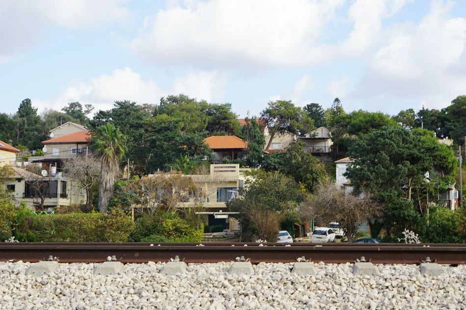 Building Exterior Tree Built Structure House Outdoors Architecture Sky No People Day Nature Train Line Train Lines City Village Adapted To The City Israel Miles Away