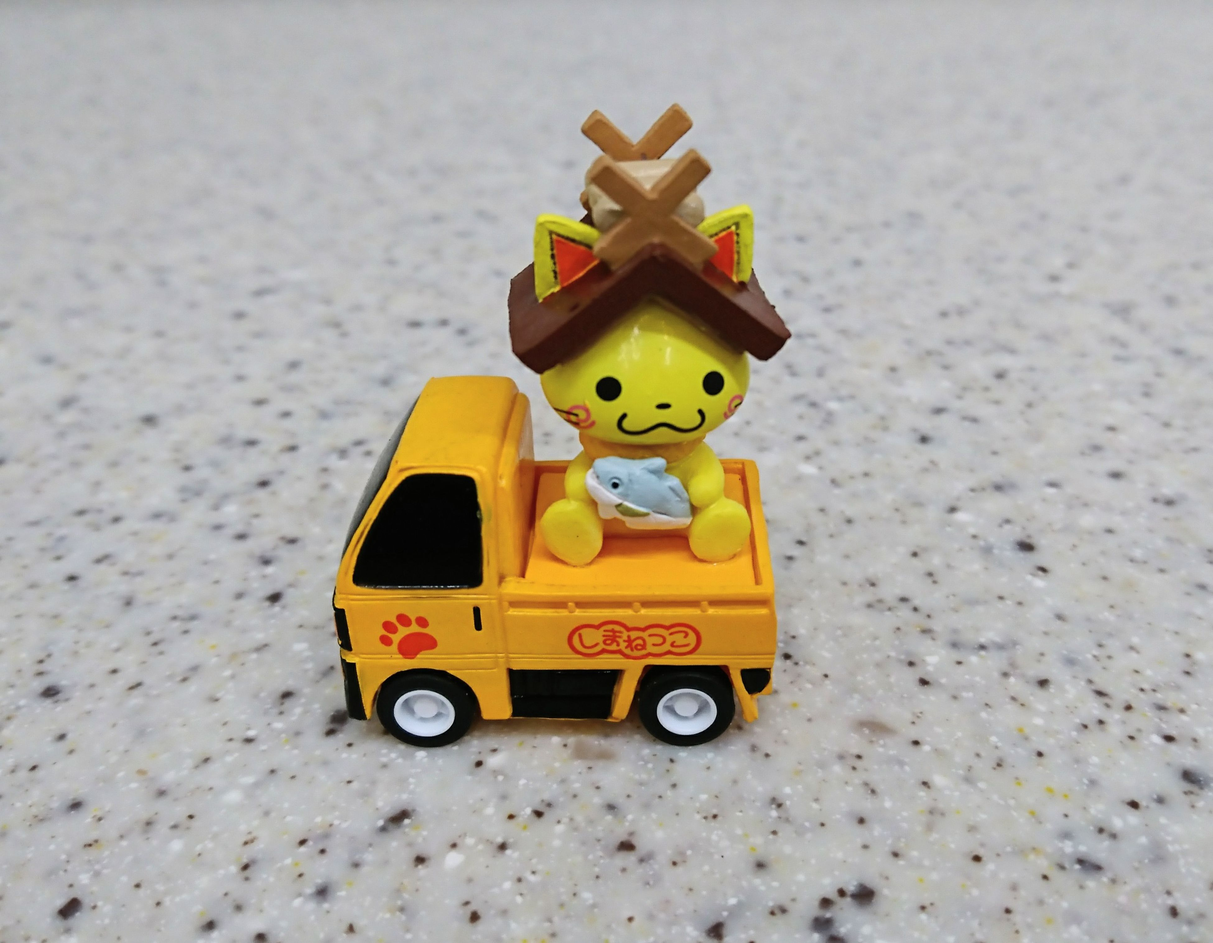 toy, childhood, toy car, land vehicle, multi colored, transportation, sand, car, no people, figurine, stationary, yellow, day, model - object, outdoors, close-up, sand pail and shovel