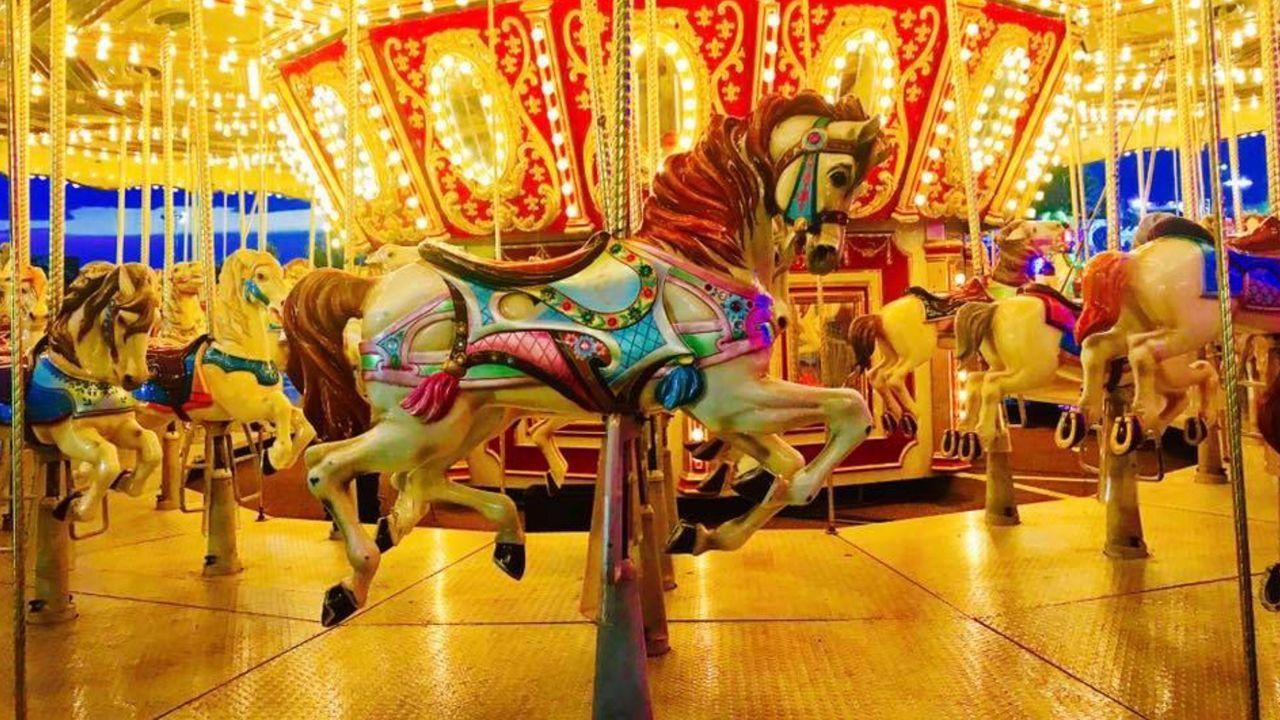 amusement park, carousel horses, carousel, animal representation, amusement park ride, horse, arts culture and entertainment, no people, merry-go-round, illuminated, multi colored, night, indoors, close-up