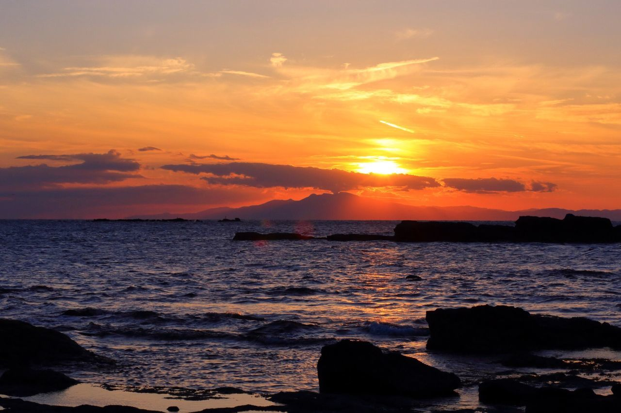 sunset, sea, beauty in nature, scenics, orange color, water, nature, sky, silhouette, tranquility, tranquil scene, beach, cloud - sky, horizon over water, no people, sun, wave, outdoors, travel destinations