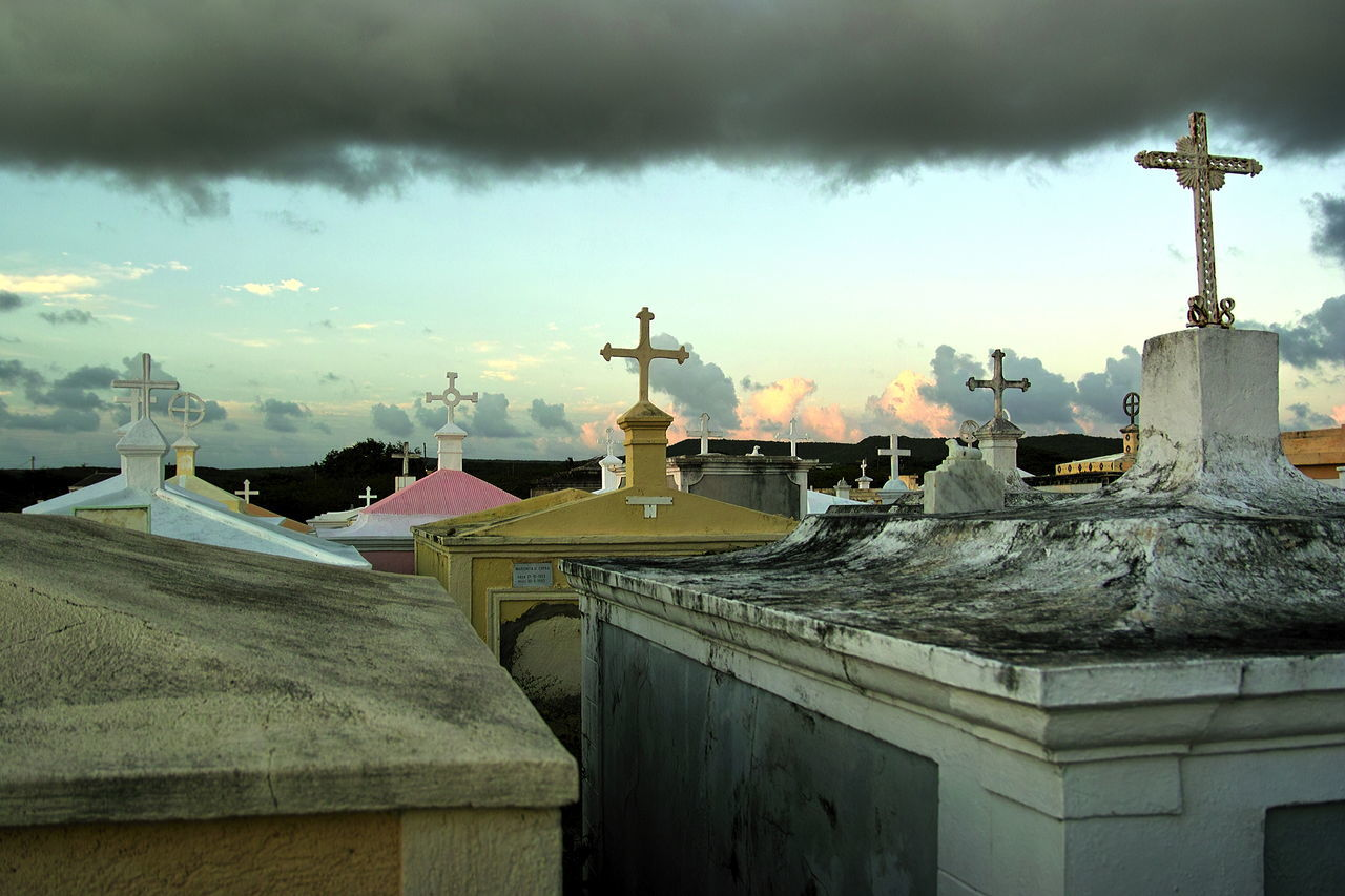 Bank of clouds over the old graveyard of St. Willibrordus, Curaçao Architecture Astronomy Built Structure Cemetery Cloud - Sky Clouds Crosses & Headstones Curacao Day Dome Graveyard Beauty Mountain No People Old Graves Old Graveyard Outdoors Sky