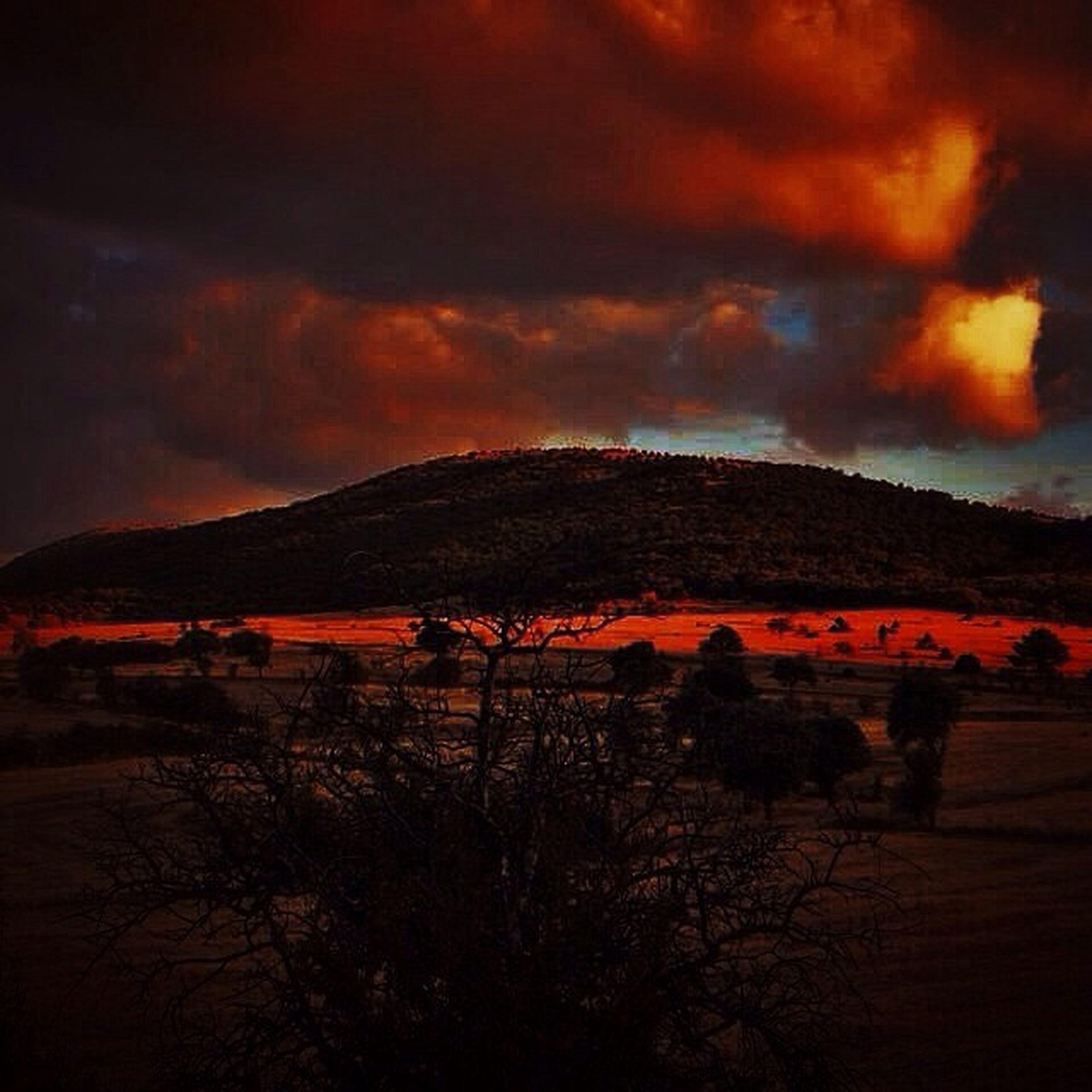 sunset, tranquil scene, sky, scenics, landscape, tranquility, beauty in nature, cloud - sky, nature, orange color, field, idyllic, dramatic sky, mountain, tree, cloud, silhouette, cloudy, non-urban scene, dusk