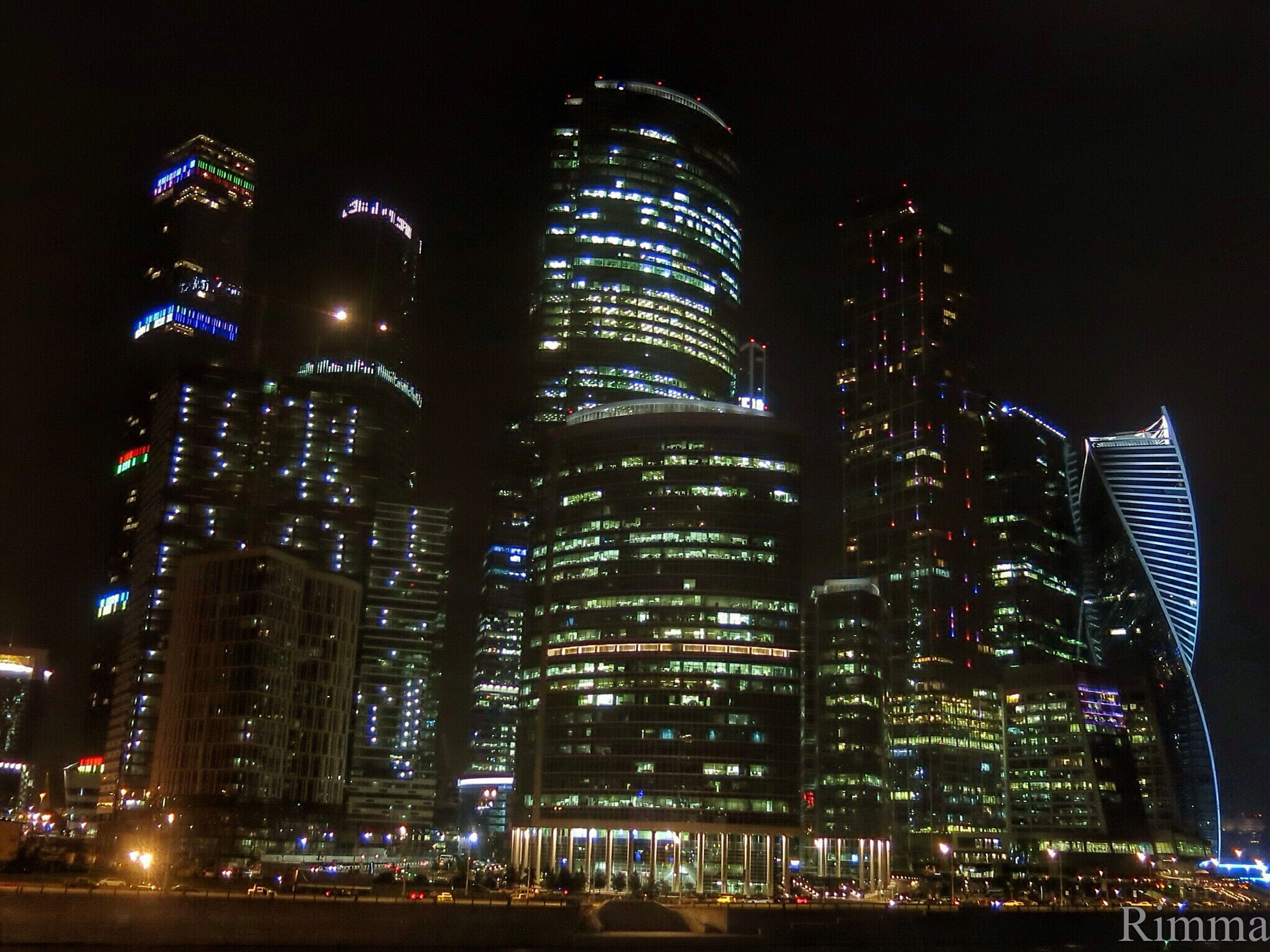 illuminated, skyscraper, building exterior, night, city, architecture, tall - high, built structure, urban skyline, tower, modern, growth, cityscape, low angle view, office building, sky, development, tall, building story, city life, financial district, outdoors, spire, capital cities, skyline, urban scene