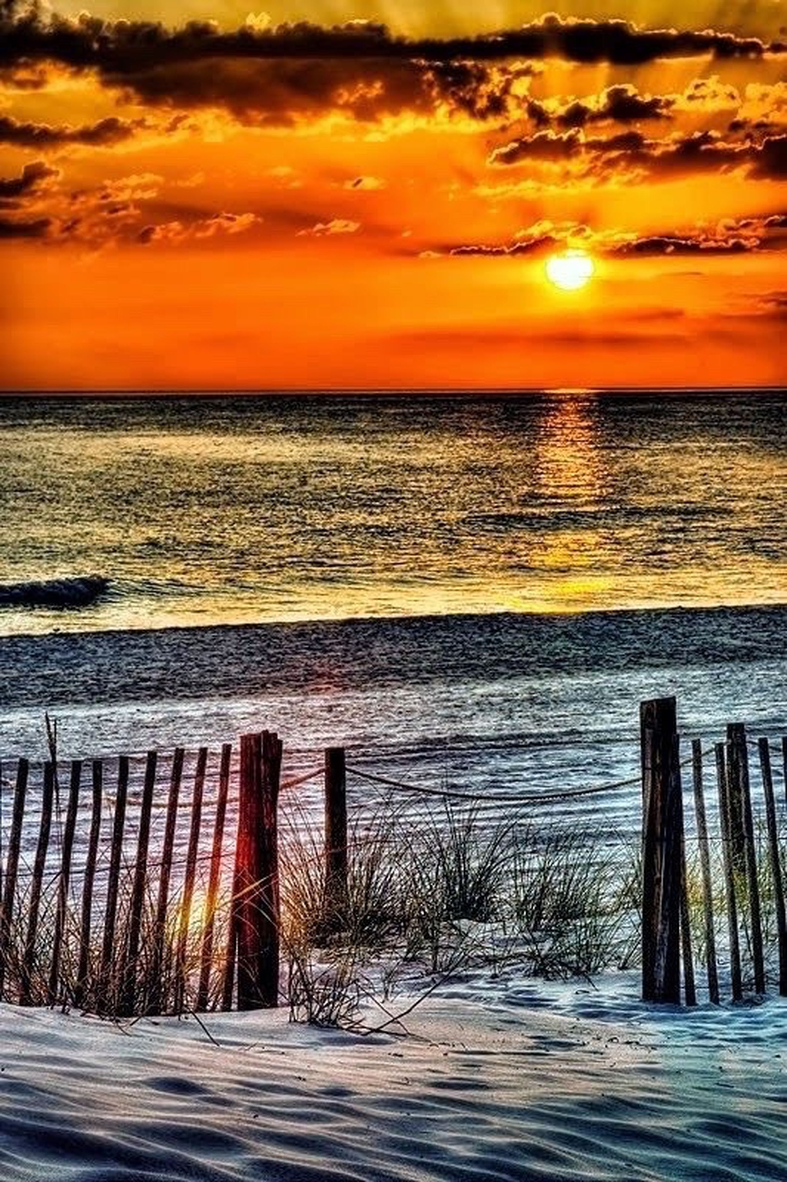 sunset, sea, orange color, beach, water, beauty in nature, nature, tranquility, tranquil scene, horizon over water, scenics, no people, outdoors, sand, splashing, sky, dramatic sky, wave, day
