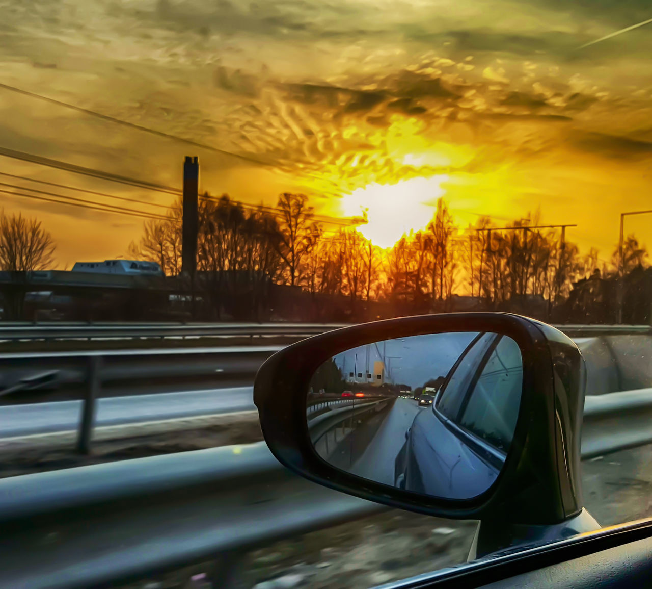 car, land vehicle, side-view mirror, transportation, sunset, mode of transport, glass - material, car interior, reflection, sky, vehicle mirror, cloud - sky, road trip, windshield, road, travel, car point of view, no people, water, close-up, nature, outdoors, tree, city, day