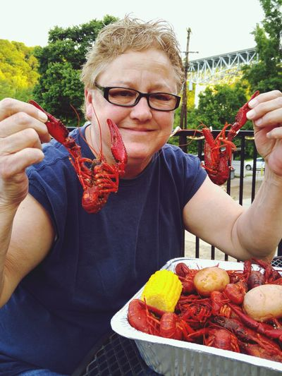 One Person Happiness Smiling Holding Crawfish Time Hot And Spicy Crawfish Yumyum Eyeglasses  One Woman Only Corn On The Cobb Crawdaddy Eating Outside