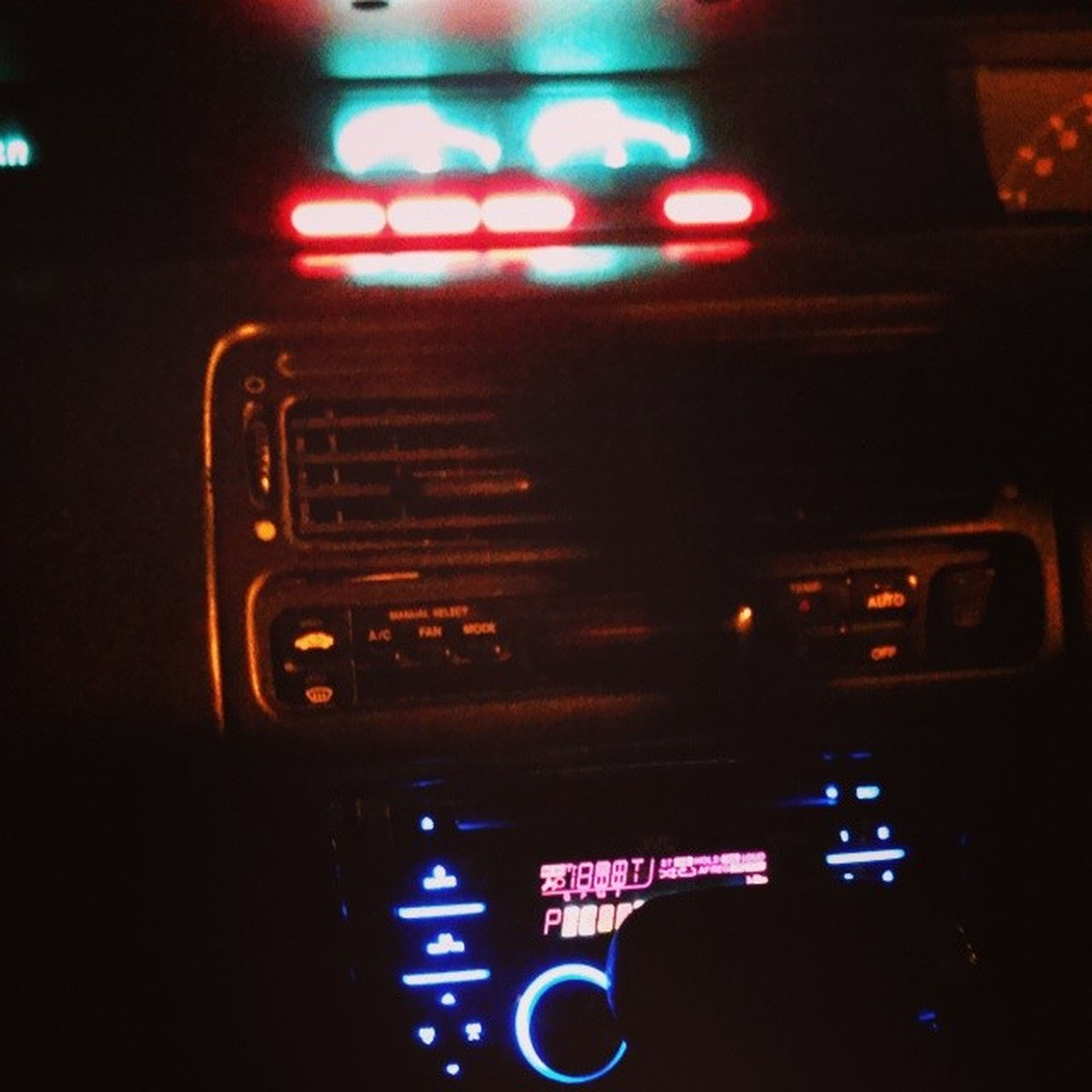 transportation, mode of transport, land vehicle, car, illuminated, communication, vehicle interior, travel, night, technology, indoors, text, car interior, on the move, dashboard, public transportation, traffic, speedometer, western script, journey