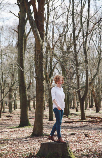 Autumn Bare Tree Blue Jeans White Shirt Branch Casual Clothing Forest Full Length Girl Growth Happiness Leisure Activity Lifestyles Nature Rear View Richmond Park, London Standing Tranquil Scene Tranquility Tree Tree Trunk Walking WoodLand The Portraitist - 2016 EyeEm Awards Natural Light Portrait People And Places