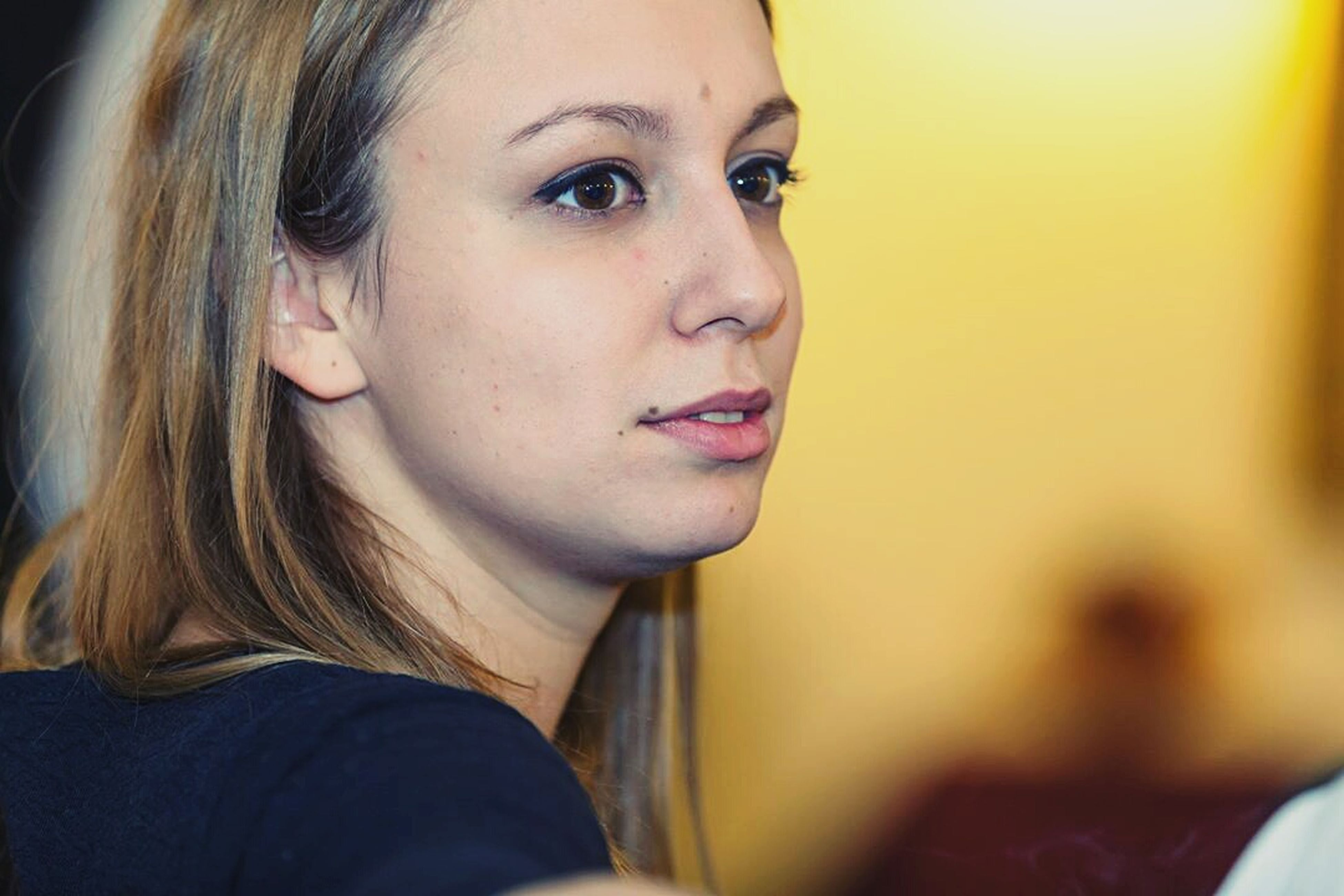 headshot, person, young adult, lifestyles, looking at camera, portrait, young women, close-up, leisure activity, indoors, front view, head and shoulders, focus on foreground, human face, contemplation, long hair