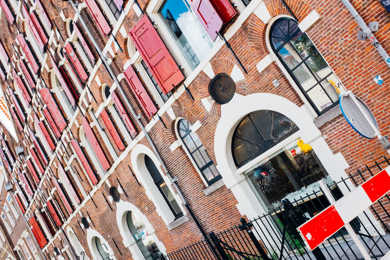 facade of a typical house in Amsterdam Architecture Architecture Brick Brick Wall Building Exterior Built Structure Day Door Exterior Low Angle View Netherlands No People Resedential Building Residential Structure Sterdam Window