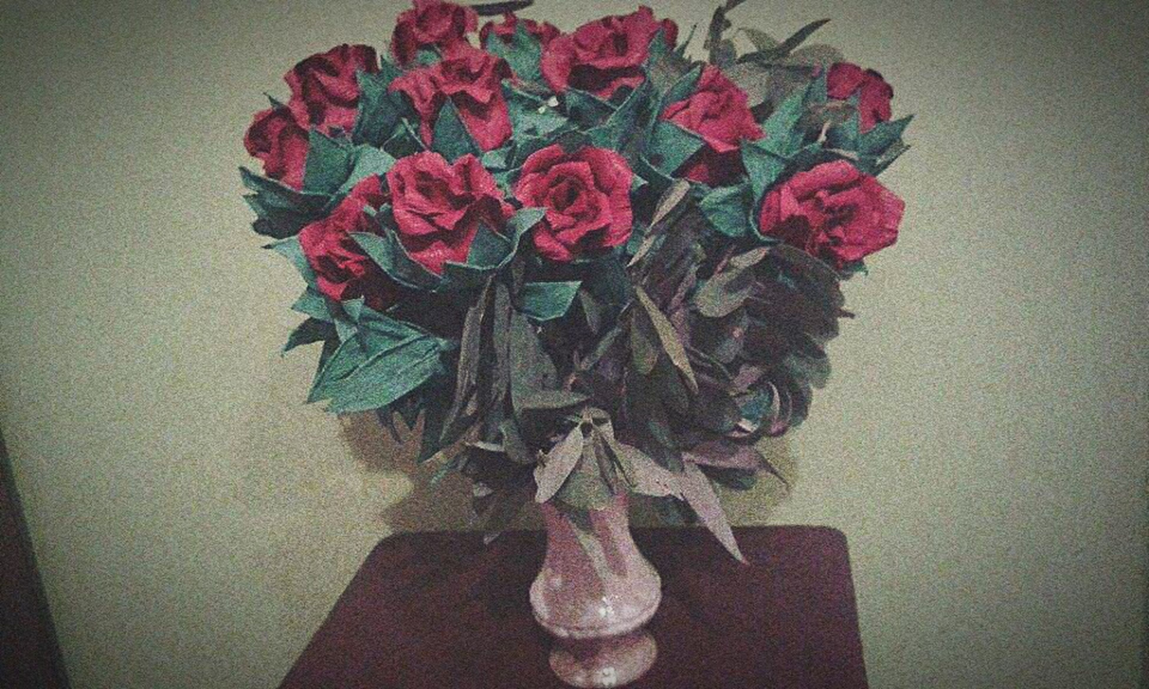 indoors, wall - building feature, still life, high angle view, close-up, flower, vase, table, home interior, art and craft, red, decoration, creativity, no people, rose - flower, art, wall, paper, shadow, bouquet