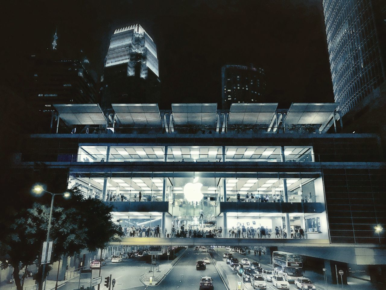 Architecture Built Structure Illuminated Transportation Night Building Exterior Travel Destinations City No People Outdoors Sky Apple Store HongKong Hongkong Photos Hong Kong IPhone 7 IPhoneography Urban Skyline Urbanphotography Nightphotography Low Light Cityscape Cyanotype Crowded City Life