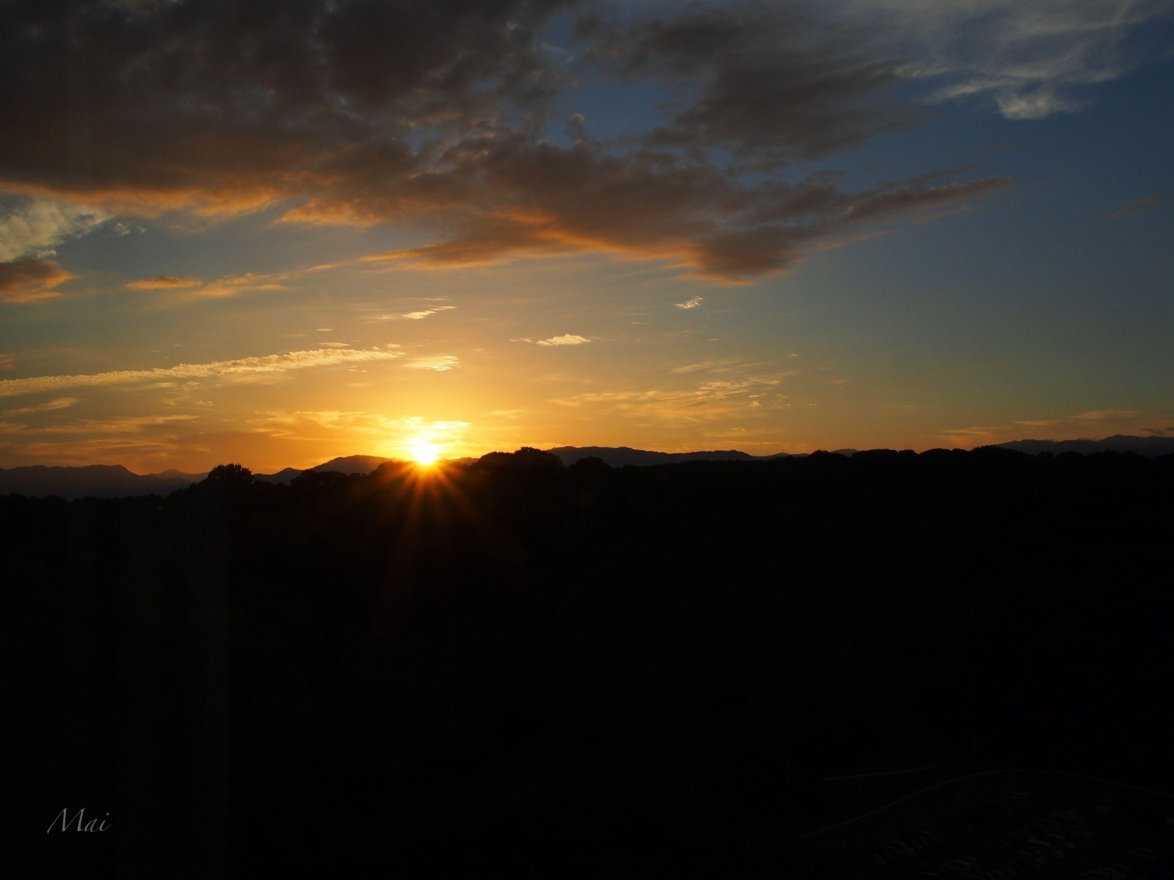 sunset, silhouette, sun, scenics, tranquil scene, beauty in nature, sky, tranquility, orange color, idyllic, nature, landscape, sunlight, dark, cloud - sky, cloud, outline, sunbeam, outdoors, dramatic sky