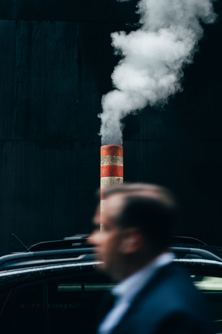 smoke - physical structure, one person, men, real people, day, air pollution, motion, close-up, outdoors, people