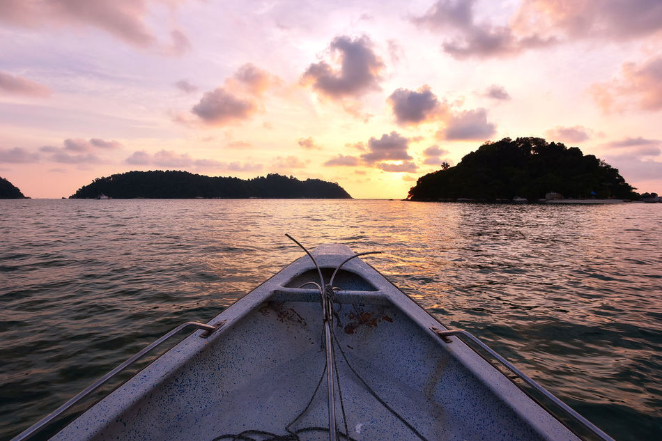 Watching beautiful sunset over the sea in Pangkor Island from the boat Adventure Beauty In Nature Beauty In Nature Boat Day EyeEm Best Shots EyeEm Gallery EyeEm Nature Lover Getty Images Holiday Island Kayak Nature Nautical Vessel No People Outdoors Relaxing Scenics Sea Sea View Seascape Sky Sunset Travel Water