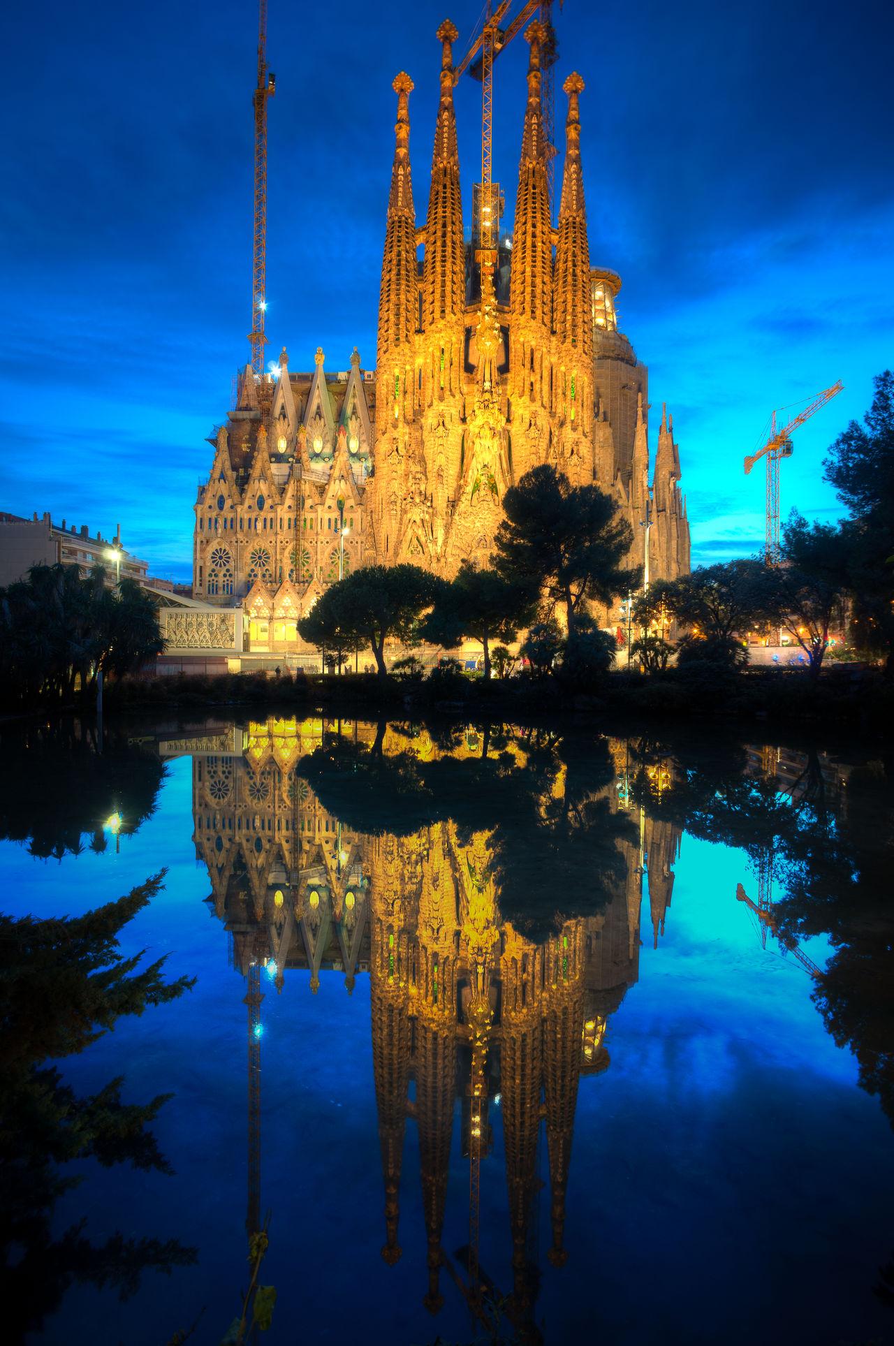 Sagrada Família Antoni Gaudí Architecture Barcelona Building Exterior Built Structure Church Gaudi Gaudi #barcelona Gaudì Architecture Work History Illuminated Night No People Outdoors Reflection Sagrada Familia Sagradafamilia Sky SPAIN Symmetry Travel Destinations Water