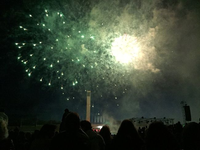 Arts Culture And Entertainment Celebration Dark Enjoyment Event Exploding Firework Display Glowing Group Of People Illuminated Large Group Of People Leisure Activity Lifestyles Low Angle View Medium Group Of People Men Motion Night Person Silhouette Sky Sparks Standing Togetherness Watching