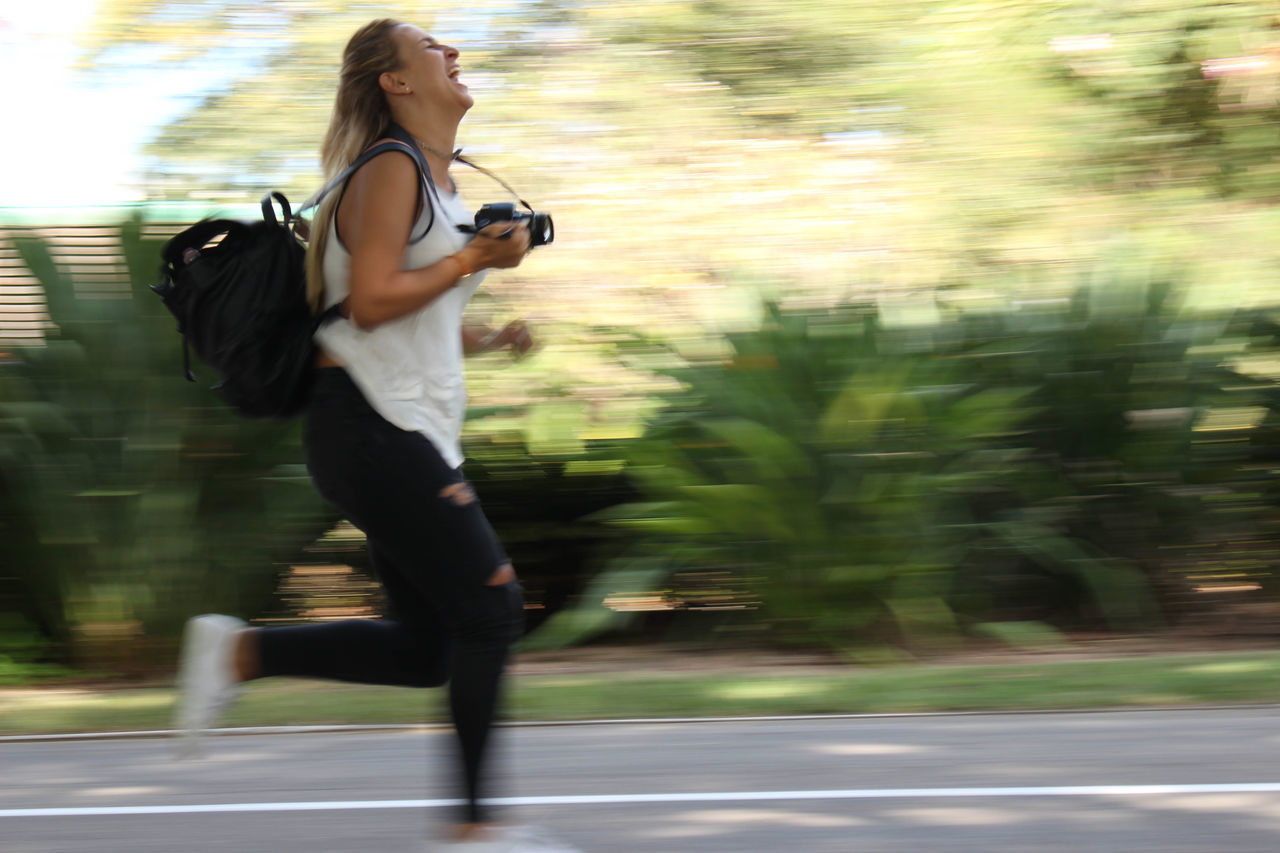 Running photographer Activity Blurred Motion Motion Only Women Running Woman Tel Aviv Streets Sports Photography EyeEmNewHere Joy Happiness Exhilaration Fast Track Fast Woman
