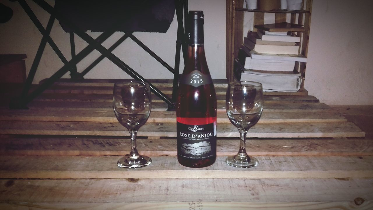 Rosed'anjou Wineglass Bottle Wine Drink Alcohol Wood - Material Indoors  Table Red Wine Food And Drink No People Drinking Glass Day Close-up Freshness Wine Not First Eyeem Photo