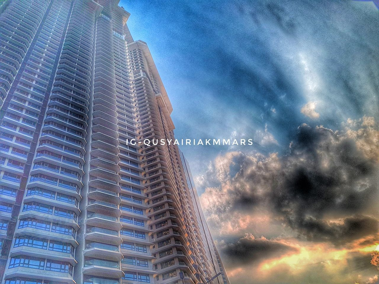 skyscraper, low angle view, architecture, built structure, sky, building exterior, outdoors, no people, day, city, modern, growth, tall