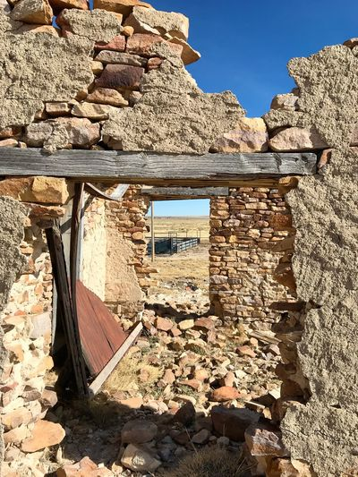 """""""Mystery Ranch"""" For over four years I have driven past this abandoned ranch house set back off Highway 42 in New Mexico, always wanting to photograph it. My hesitation was a gated fence onto the private ranch land. Finally on January 2, 2018 I parked my truck at the gate, climbed over it and walked the near mile into the property and shot my long desired series of the ranch dwellings and surrounding area. It's a mysterious set of buildings and inspecting it only made my curiosity grow even more wondering what the story and history behind it was. Thus I've titled the series """"Mystery Ranch."""" It includes both black and white interpretation as well as color as the subject demanded both in its varied study. No. 2 in series. Ranch New Mexico Photography New Mexico Stone Abandoned Buildings Abandoned Places Day Built Structure Architecture Outdoors No People"""