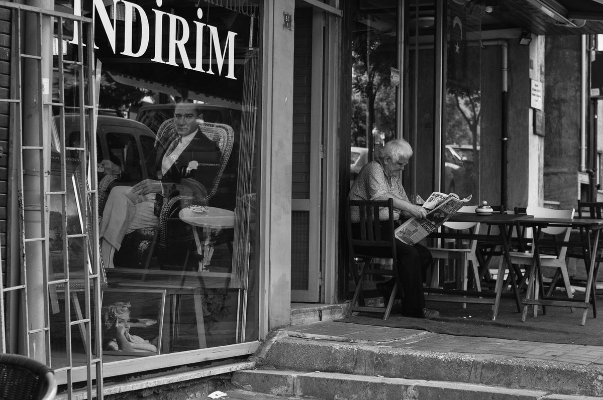Atatürk's Heritage Atatürk BW Collection Bw_collection Bw_lover BW_photography Bws_worldwide Cafe Time Heritage Indirim Means Sale Lifestyles Look Into The Past Morning News Morning Newspaper Picture Of Atatürk Reading Newspater Sitting Street Life Photos Street Life Style Street Photography Streetphoto_bw Woman Reading