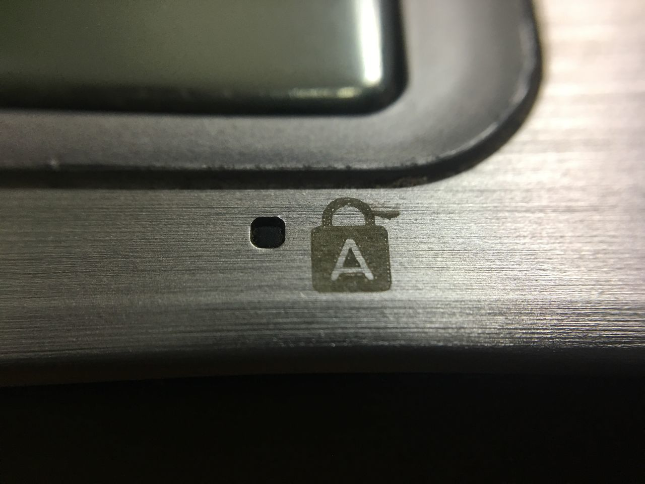 Status Macro Iron - Metal Stainless Steel  Silver - Metal Aluminum No People Close-up Indoors  Day Doodle Sign LED Symbol Surface Key Lock