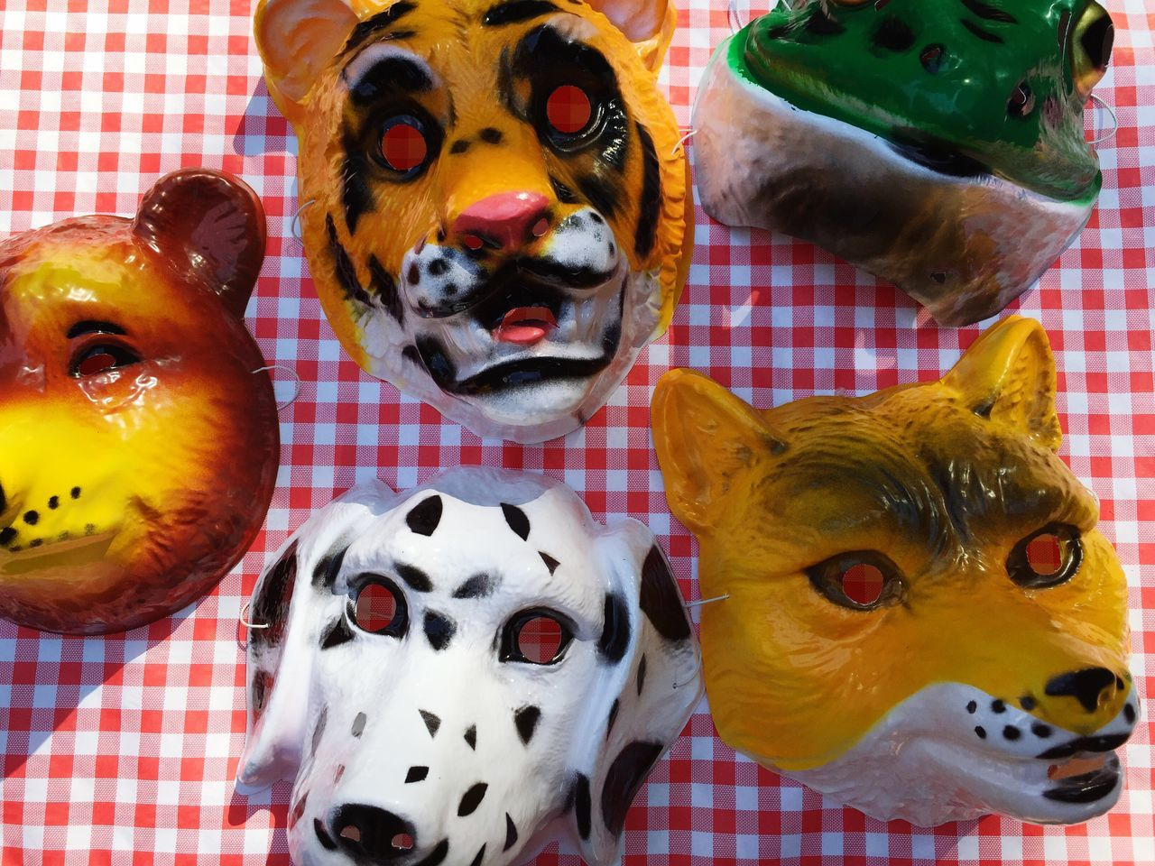 Close-Up High Angle View Of Animal Masks On Table