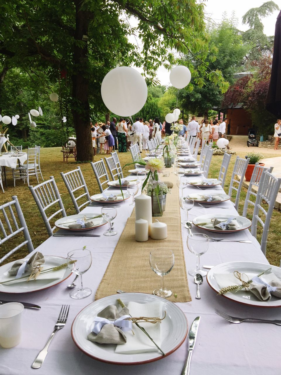 table, place setting, plate, chair, outdoor cafe, dining table, outdoors, tree, fork, napkin, celebration, day, no people