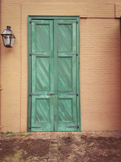 French Quarter Door and lantern lamp Door Closed Wood - Material Outdoors Safety No People Protection Day Built Structure Green Color Building Exterior Architecture Full Frame Close-up French Quarter New Orleans French Quarter Architecture Green Color Lantern Lamp Lantern Firehouse Louis Armstrong Park Building Painted Brick Painted Brick Building The Graphic City Colour Your Horizn