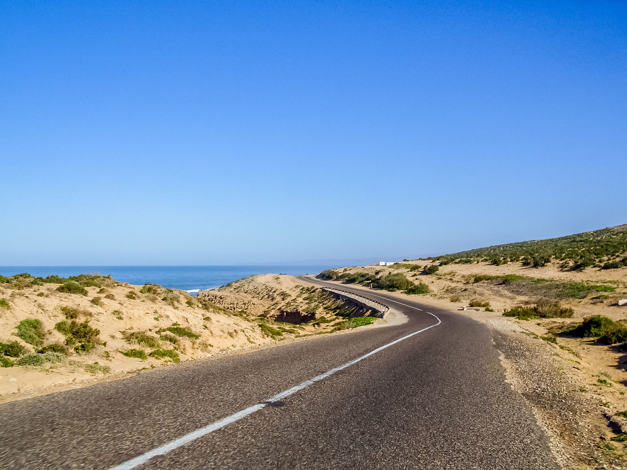 Street at the morocean coast Beach Beauty In Nature Blue Clear Sky Coastline Copy Space Day Horizon Over Water Landscape Mountain Nature No People Non-urban Scene Outdoors Road Scenics Sea Sky The Way Forward Tranquil Scene Tranquility Travel Travel Destinations Winding Road