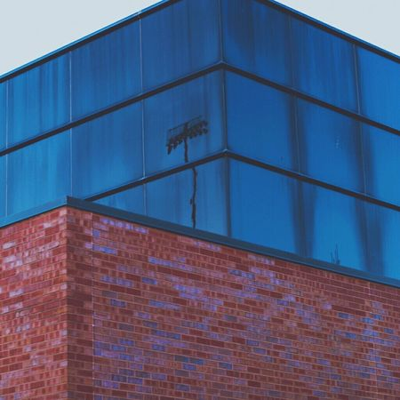 Blue Architecture Built Structure Reflection Pattern Building Exterior Outdoors No People Low Angle View Clear Sky Sky Day Close-up Minimalism Wichita State Urban Exploration Infj Proffesionalphoto Reflection Looking Into The Future Window Symbolic  Geometric Shape Sports Sports Photography