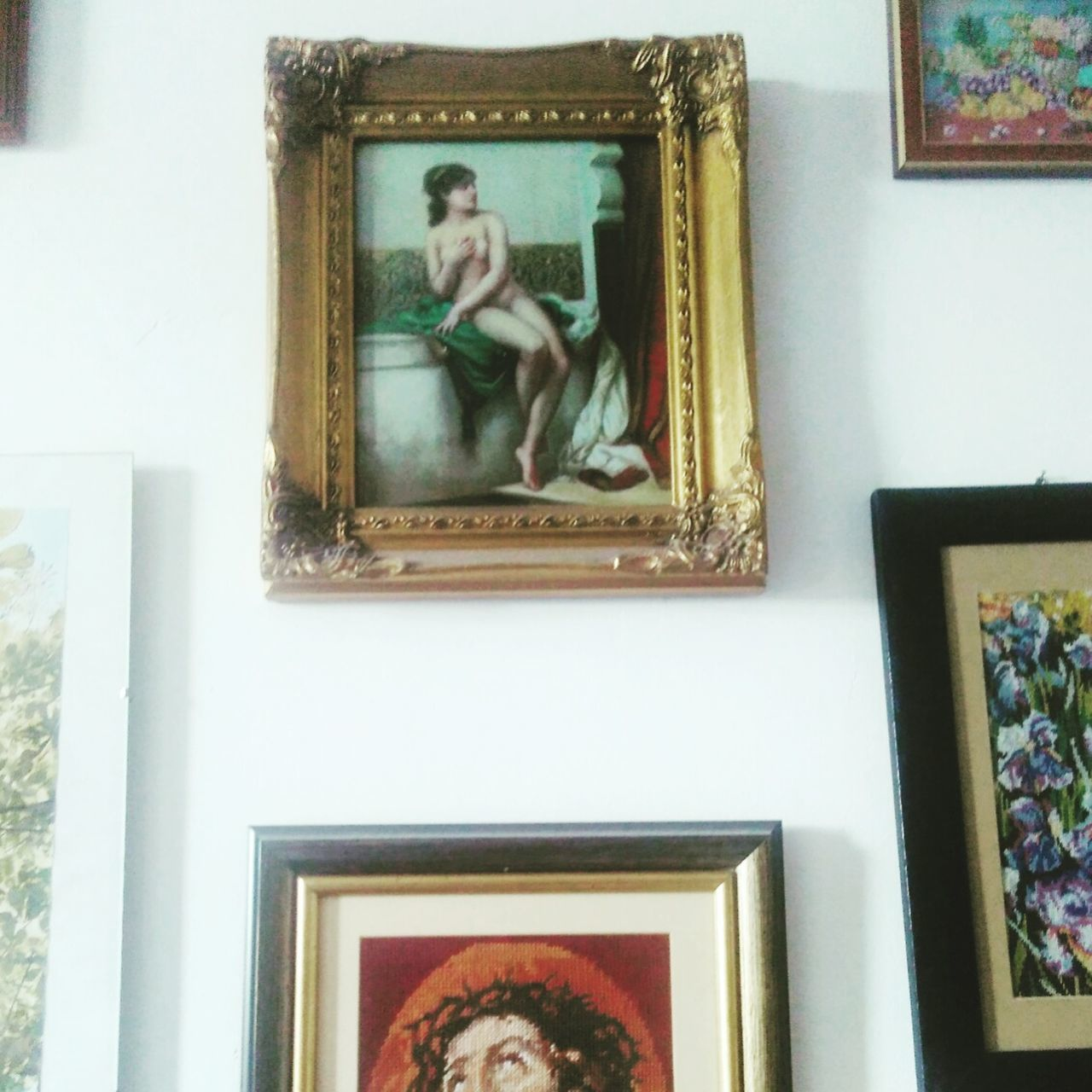 picture frame, male likeness, human representation, art and craft, indoors, female likeness, statue, no people, sculpture, day, photograph, close-up, architecture, bedroom