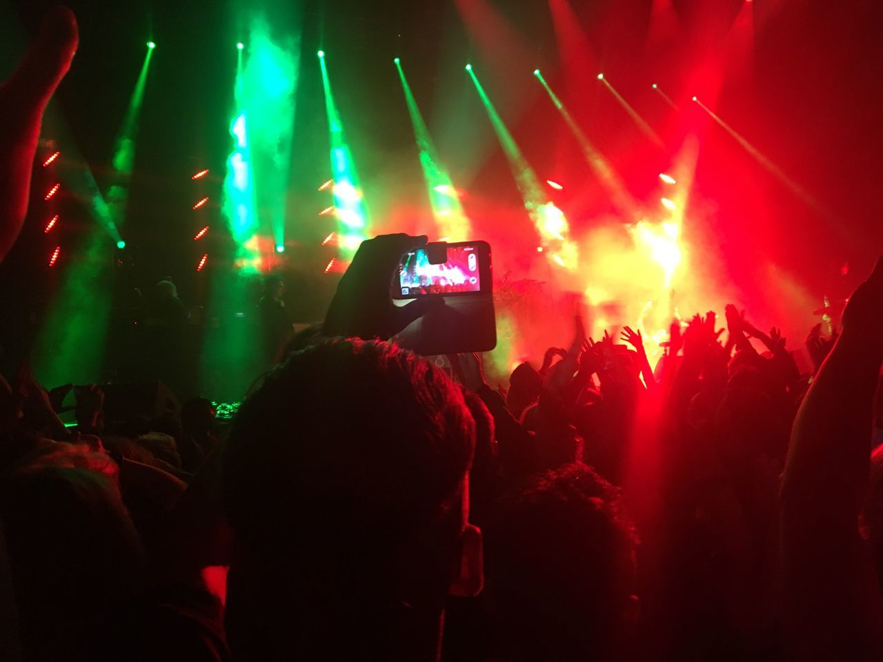 Person Crowd Wireless Technology Night Mobile Phone Smart Phone Portable Information Device Illuminated Stage - Performance Space Music Popular Music Concert Stage Light Large Group Of People Fun Technology Arts Culture And Entertainment Spectator Performance Communication Fan - Enthusiast