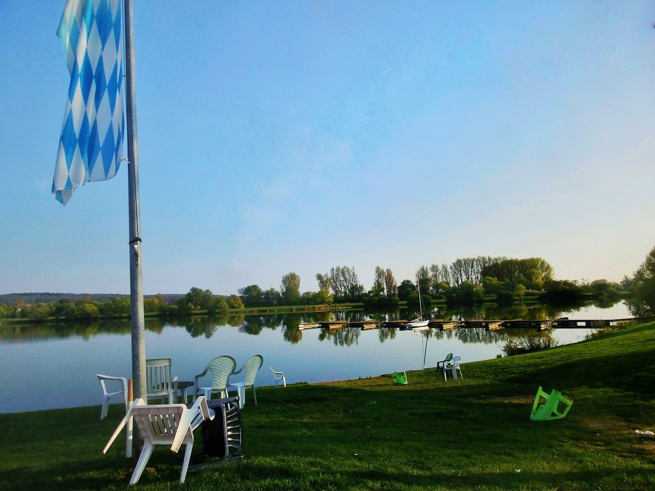 End Of A Beautiful Day (not today :( ) Sunny Day Tranquility Lakeshore Super Reflections Evening Atmosphere Quiet Waters Mirrorlike Flag In The Foreground the flag is beer advertising 😀 Empty Chairs Landscape Nature Lakeside Lake Grass Water Tree Beach Sky Day Outdoors No People Scenics Kinzigsee Langenselbold Germany🇩🇪