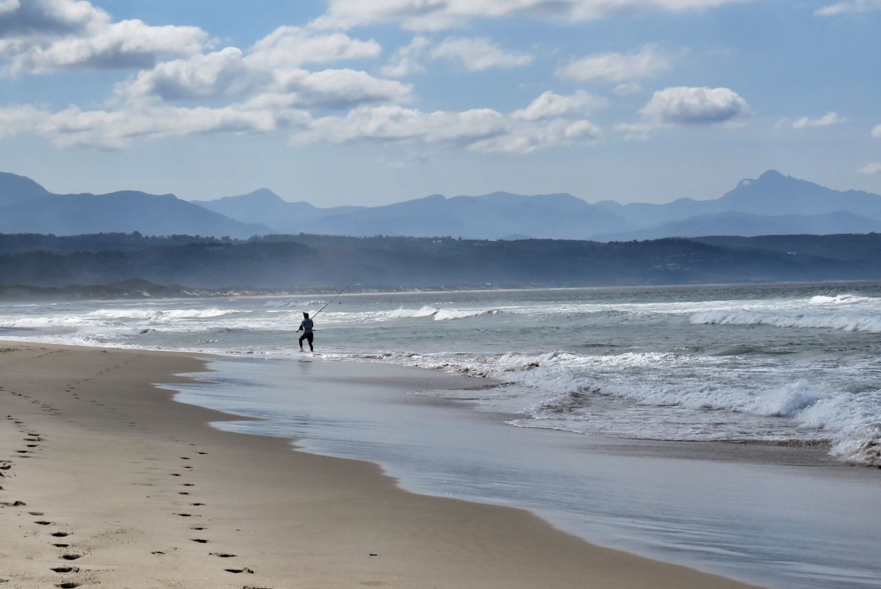 Sand Beach Full Length Sea One Person People Wave Sport Silhouette Landscape Standing Outdoors Adult Adults Only Day Paddleboarding Beauty In Nature Nature Only Women Sky Fishing Plettenberg EyeEmNewHere Southafrica